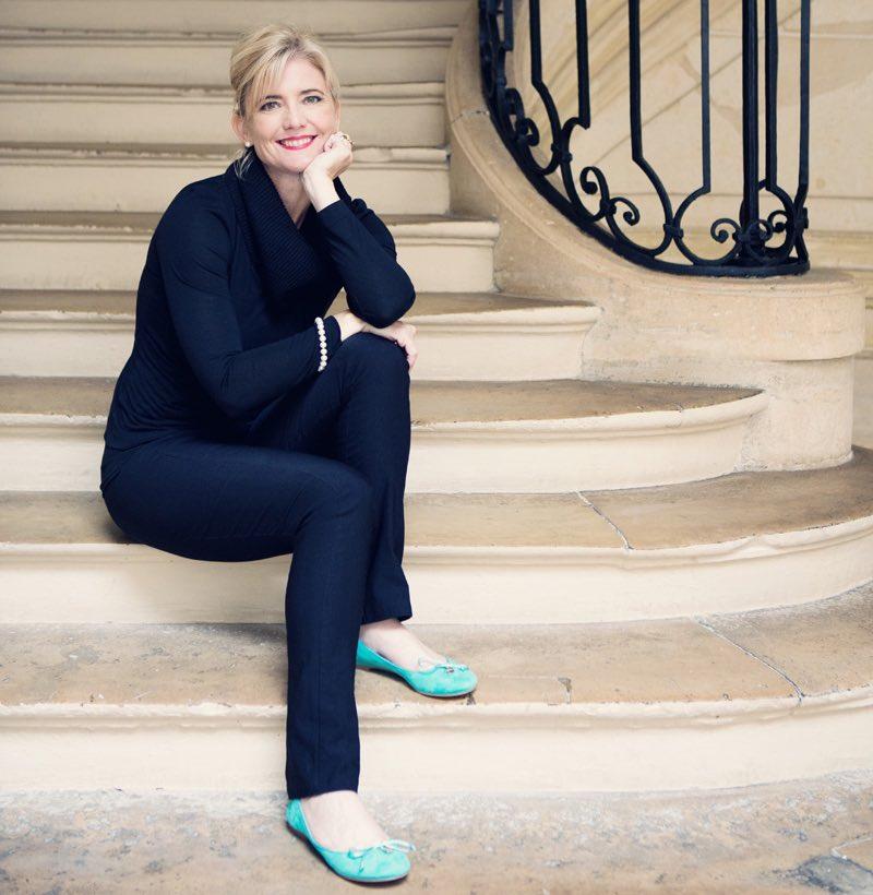 Amanda Reboul sitting on steps in Paris